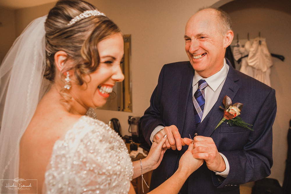 the reveal with father of the bride in suit before the wedding at the woodman inn Yorkshire leeds photographer