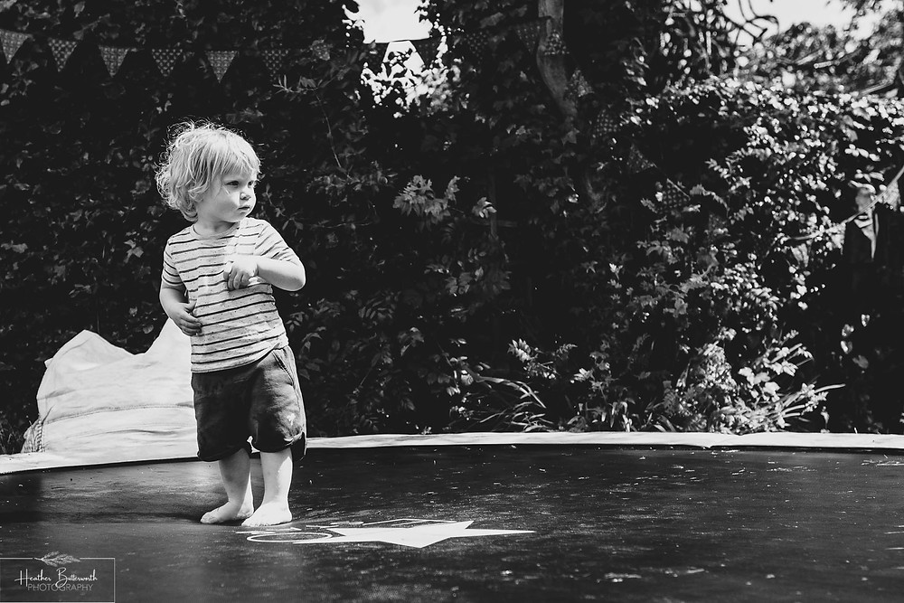 boy playing on a trampoline in a garden in leeds yorkshire in july 2020