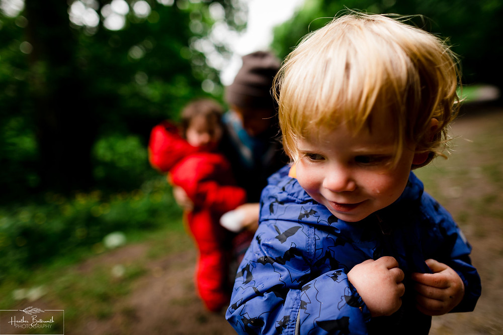 a boy playing in roundhay park woods after restrictions were slightly lifted after the COVID-19 lockdown in Leeds , Yorkshire in June 2020