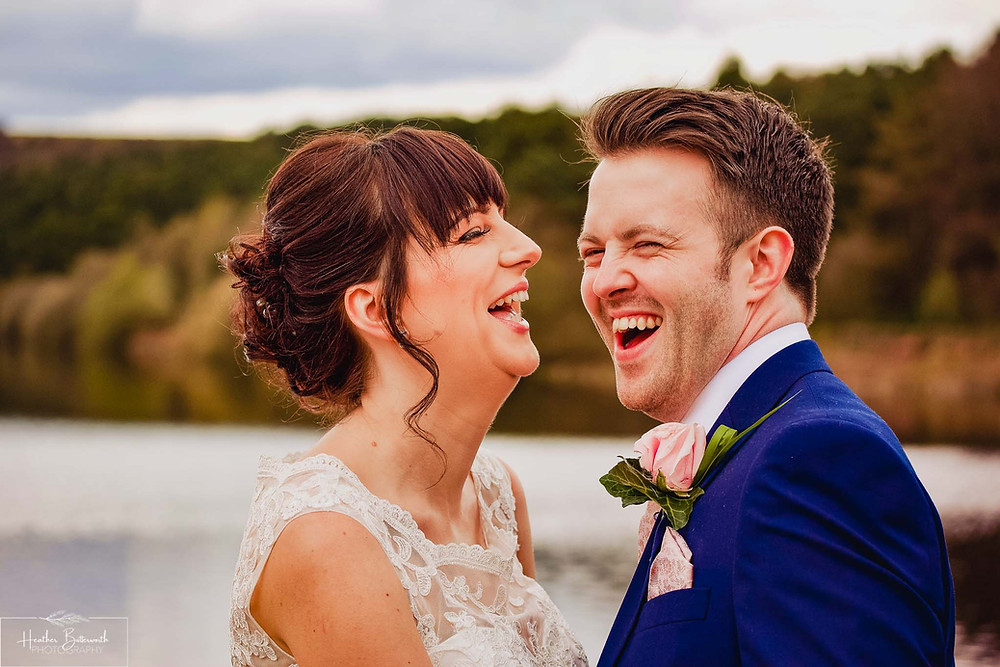 A happy bride and groom laughing together after their wedding ceremony at Moorlands Inn, Halifax, Yorkshire