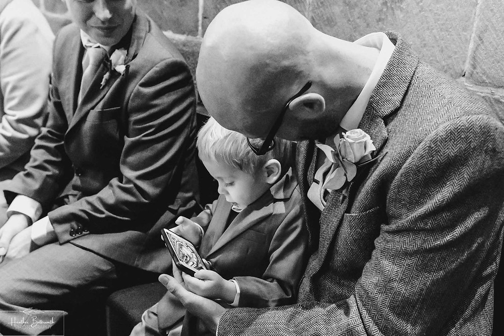 leeds wedding photographer Yorkshire adel parish church st John the baptist page boy phone