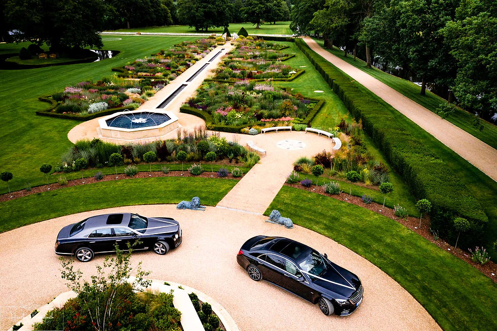 Ariel view of A Bentley Mulsanne and a Bentley GT Convertible car outside Grantley Hall, Yorkshire in July 2020