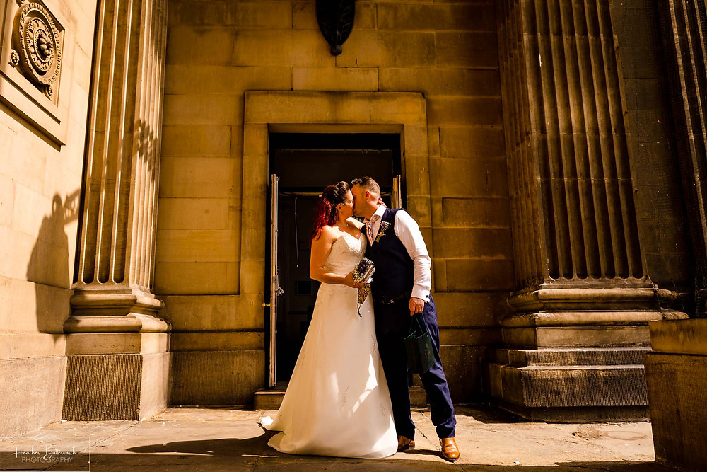 bride and groom kissing after their wedding at leeds town hall in august 2020
