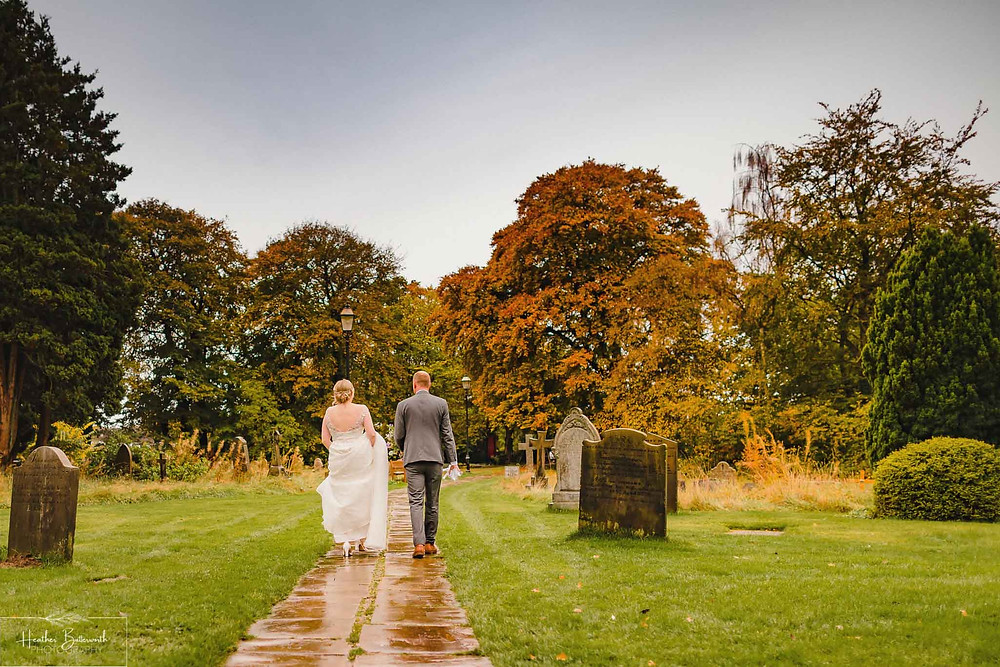 leeds wedding photographer Yorkshire adel parish church st John the baptist bride and groom autumn church grounds