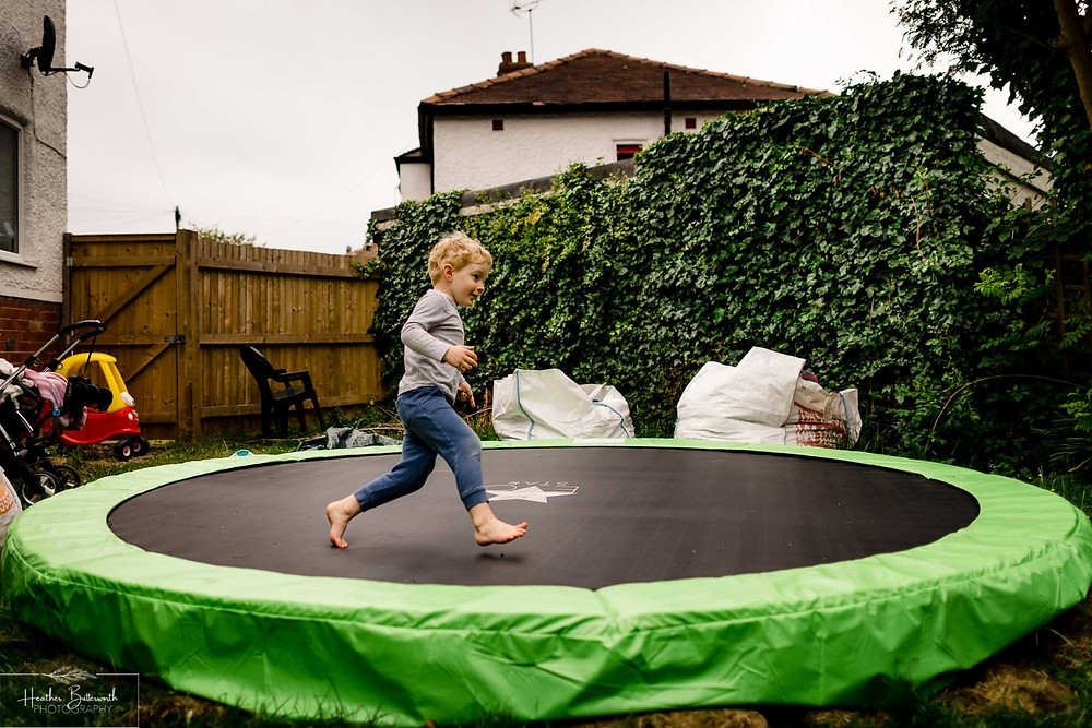 boy running on a trampoline