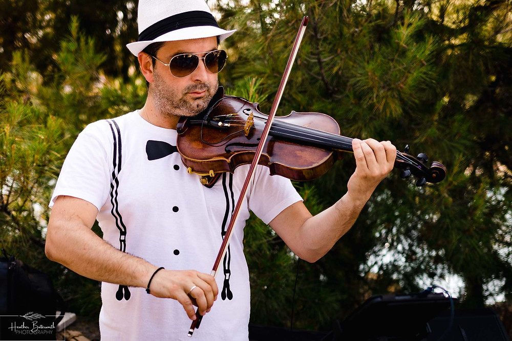 Violinist at The Boutzi wedding venue in Skiathos Town ready for a wedding ceremony in June 2019