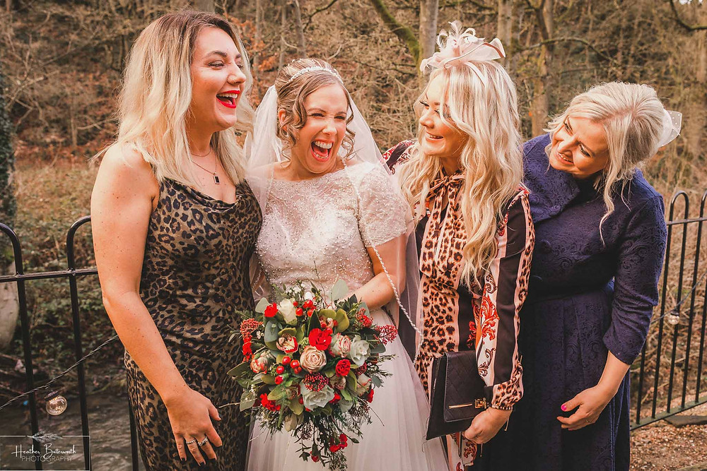 Bride with friends after her wedding ceremony at The Woodman Inn in Thunderbridge, Yorkshire