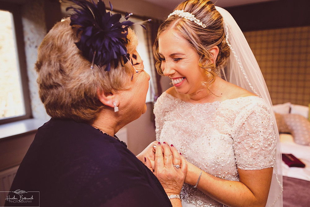 Mother of the bride with her excited daughter before her wedding at The Woodman Inn in Thunderbridge near Leeds, Yorkshire