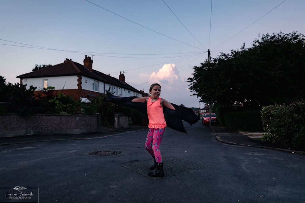 child dancing in the street at sunset in leeds yorkshire in july 2020