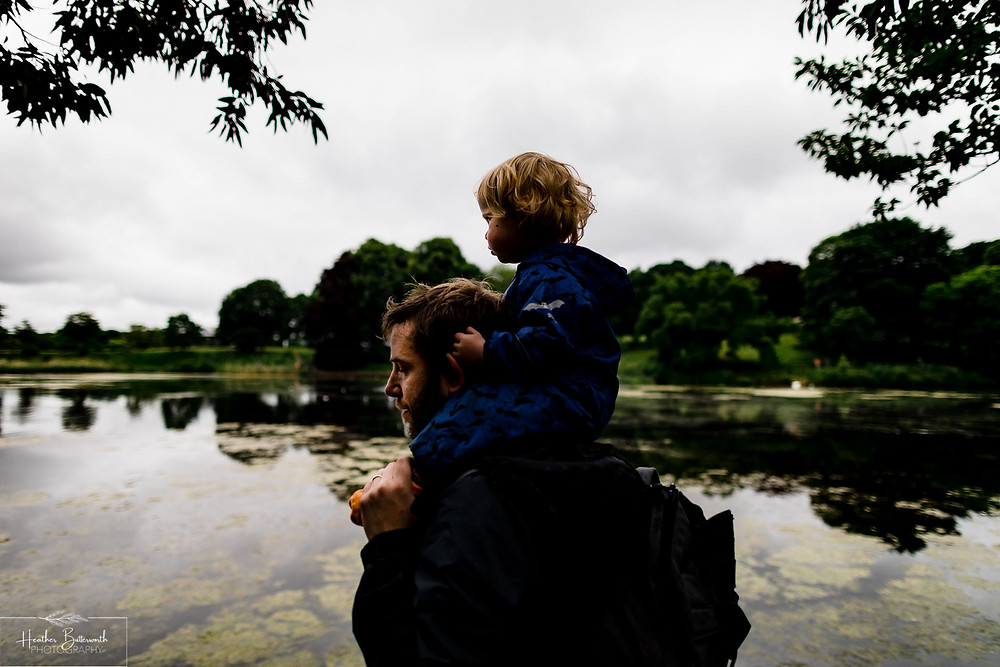 father and son at the lake in roundhay park woods after restrictions were slightly lifted after the COVID-19 lockdown in Leeds , Yorkshire in June 2020