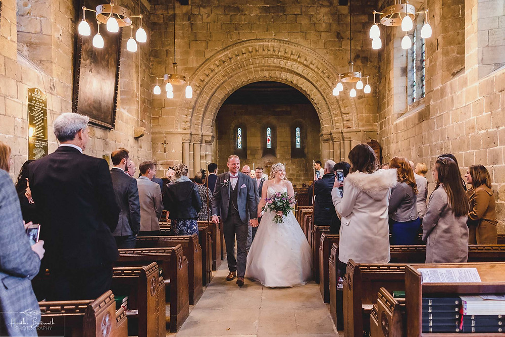 leeds wedding photographer Yorkshire adel parish church st John the baptist aisle bride and groom