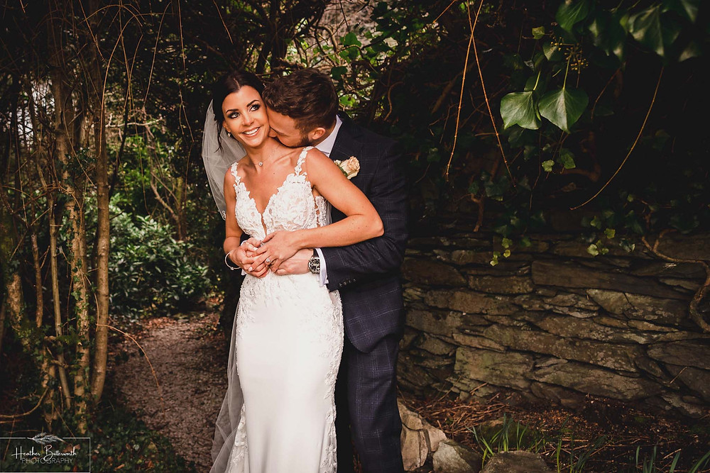 Bride Bex with her new husband Andy in the garden at The Burnside Hotel and Spa in Bowness-on-Windermere