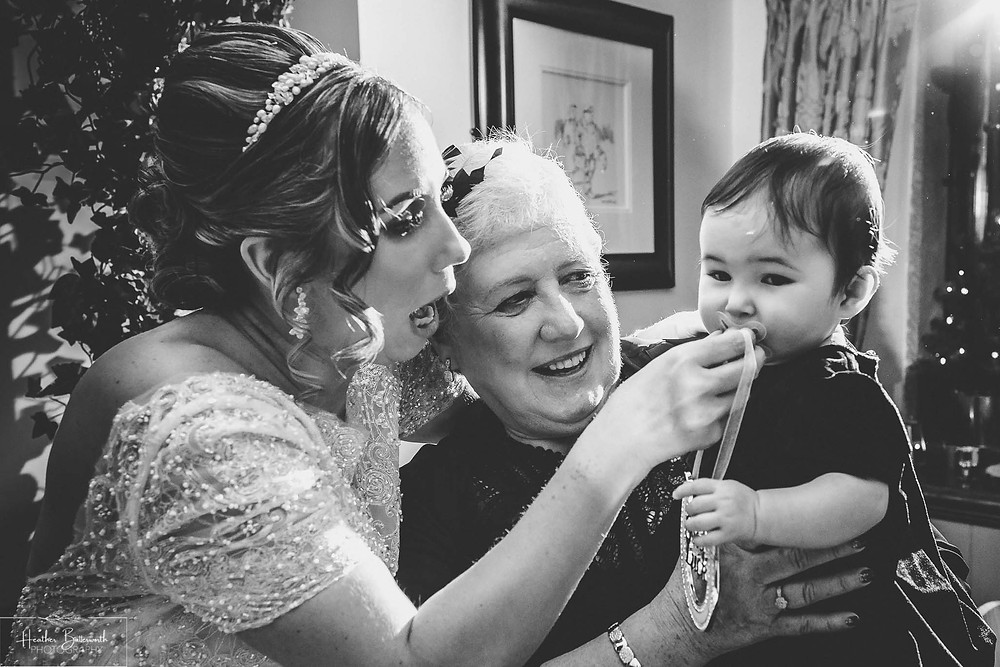 Bride with her mum and baby daughter at The Woodman Inn in Thunderbridge, Yorkshire