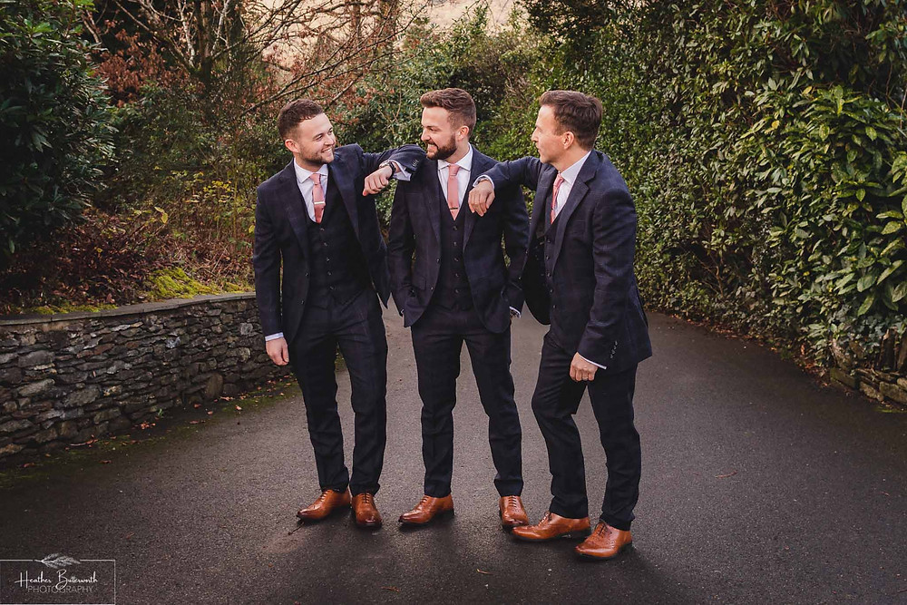 Andy the groom and his dad and brother in the garden during groom preparations at The Burnside Hotel and Spa in Bowness-on-Windermere