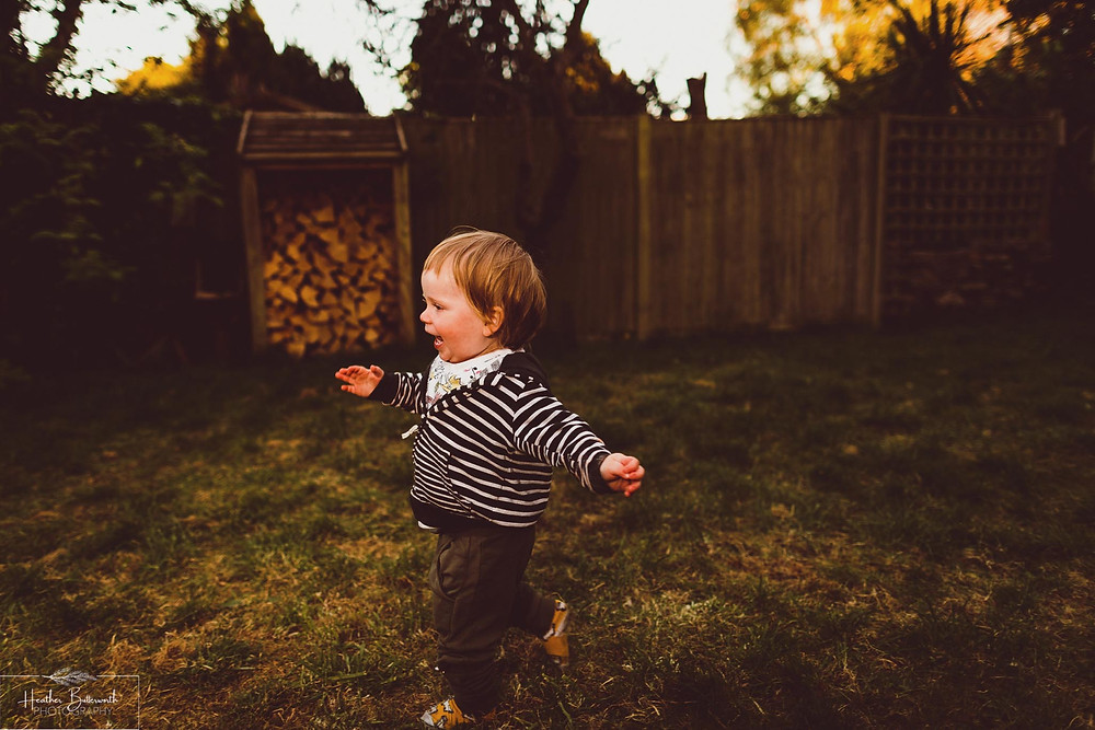 documentary family photography taken during lockdown in 2020 in Leeds Yorkshire by Photographer Heather Butterworth of a toddler running