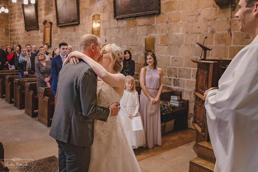 leeds wedding photographer Yorkshire adel parish church st John the baptist the kiss