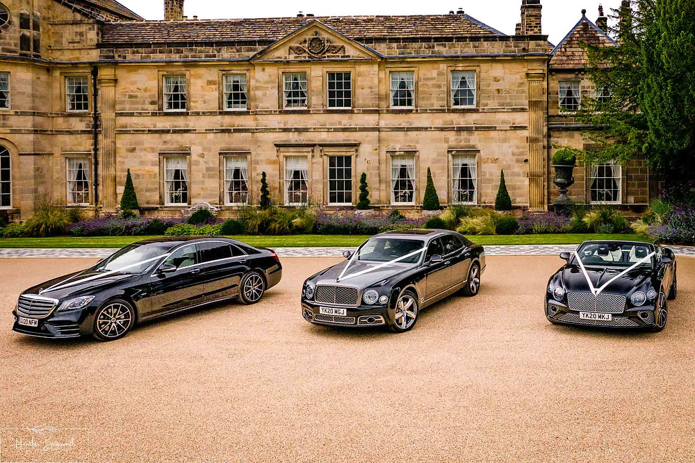 A Bentley Mulsanne and a Bentley GT Convertible car outside Grantley Hall, Yorkshire in July 2020