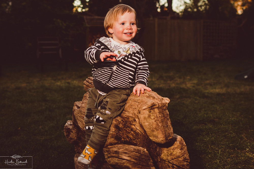 documentary family photography taken during lockdown in 2020 in Leeds Yorkshire by Photographer Heather Butterworth of boy on a rocking horse
