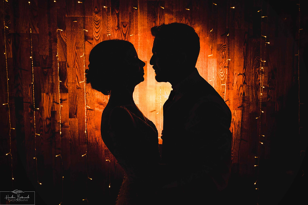 Bride Bex and Groom Andy silhouette at their evening reception at The Burnside Hotel and Spa in Bowness-on-Windermere