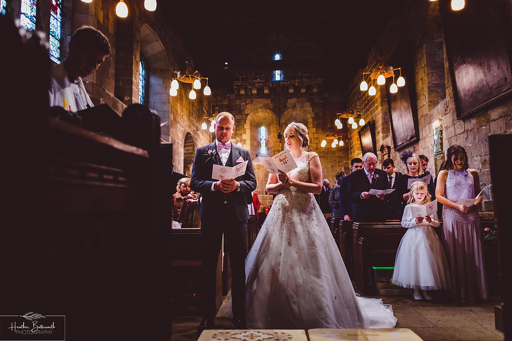 bride and groom in a church at their wedding ceremony