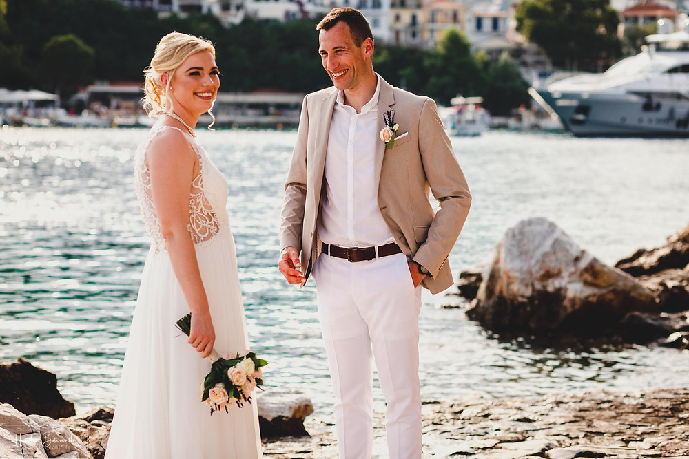 Groom looking happily at his bride after their wedding at The Bourtzi in Skiathos Town, Greece