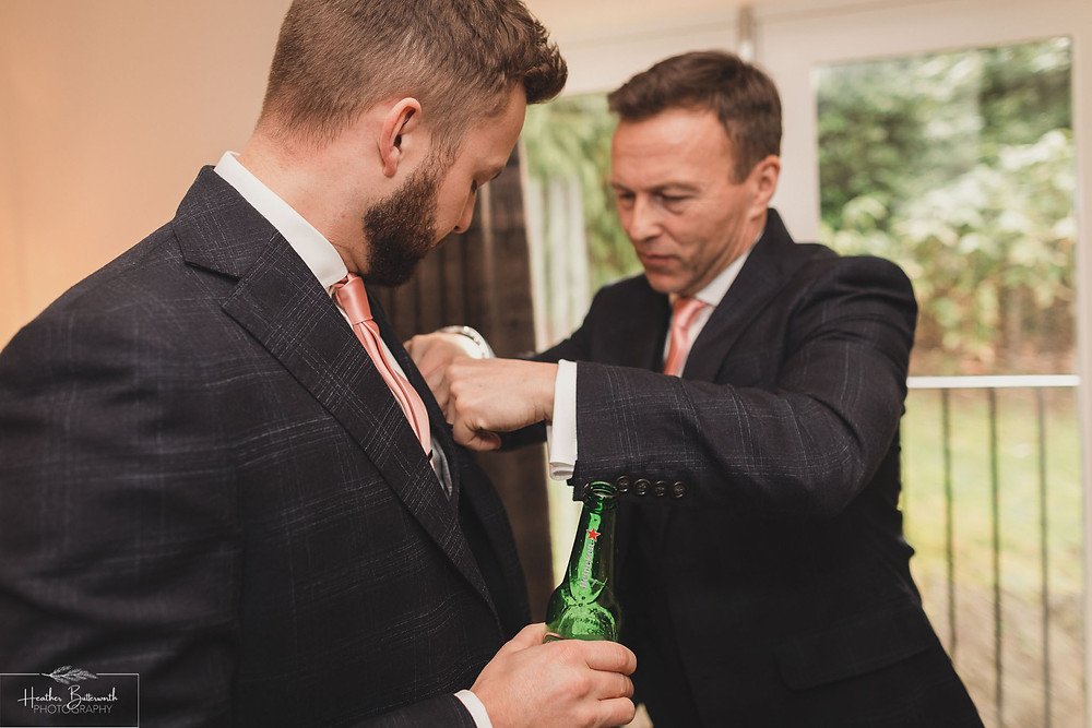 Andy the groom with his dad during groom preparations at The Burnside Hotel and Spa in Bowness-on-Windermere