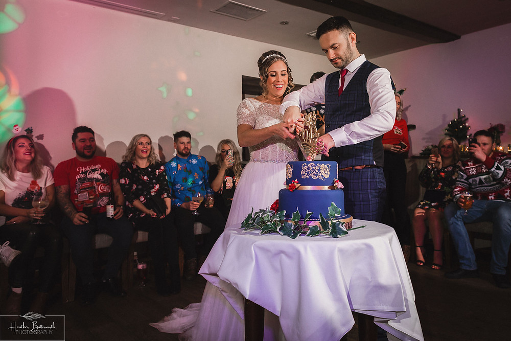 brides and groom cut the cake wedding photography at the woodman inn Yorkshire leeds photographer