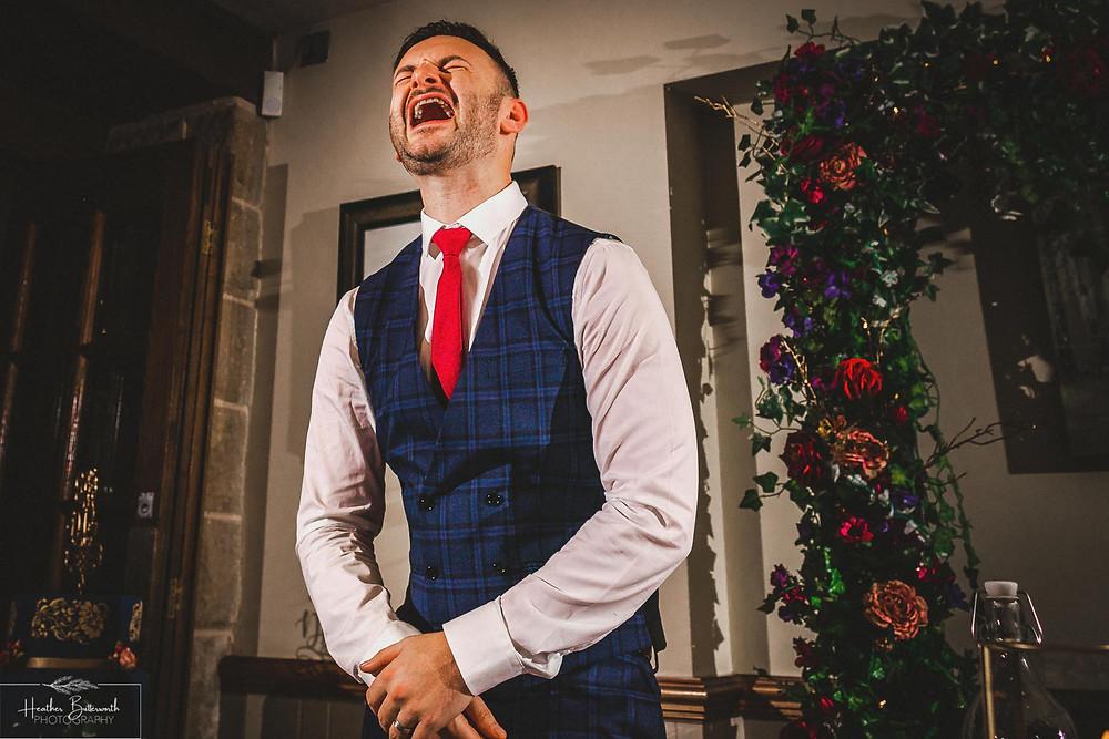 Groom laughing during the Grooms speech at The Woodman Inn in Thunderbridge, Yorkshire