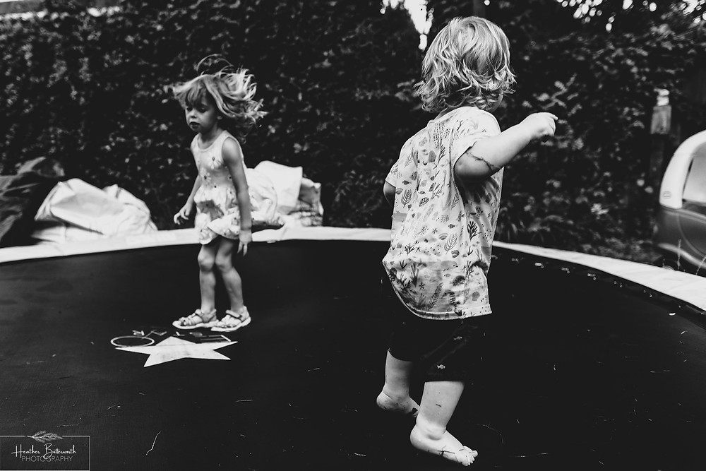 children playing on a trampoline in leeds yorkshire in july 2020