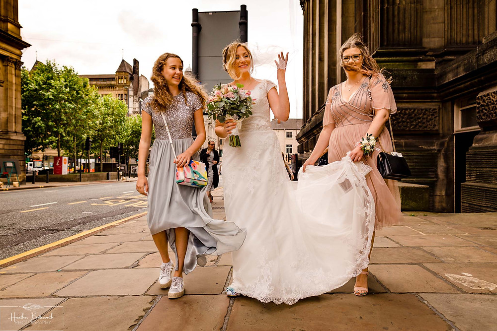 bride and her bridesmaids before her wedding in Leeds Yorkshire UK in august 2020