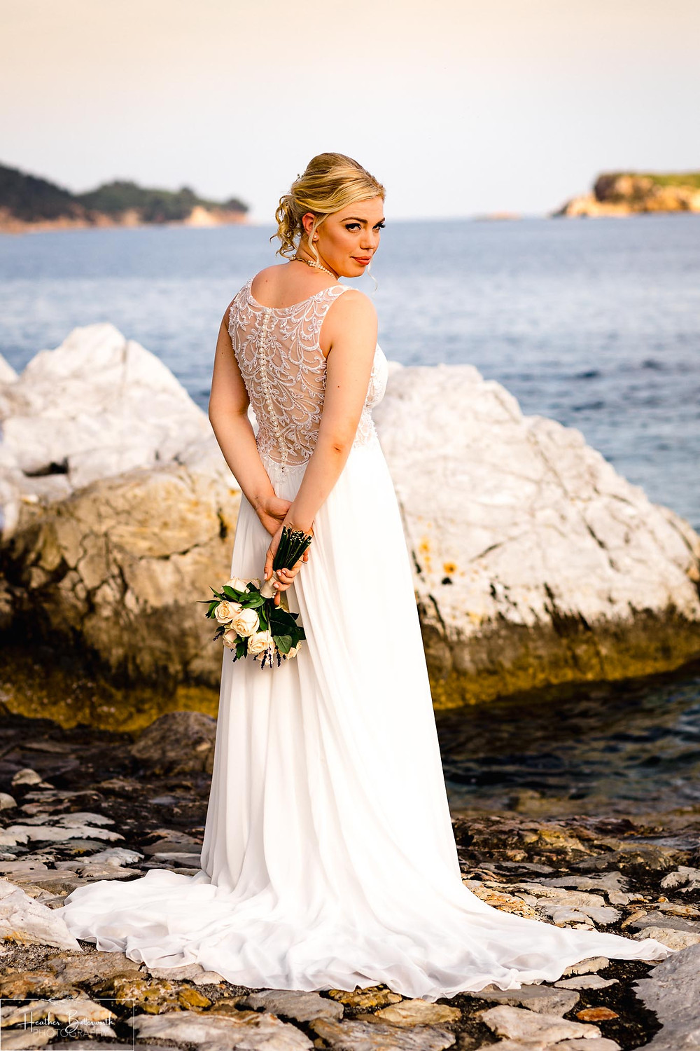 bride and groombride on the beach in skiathos town after her wedding ceremony in June 2019