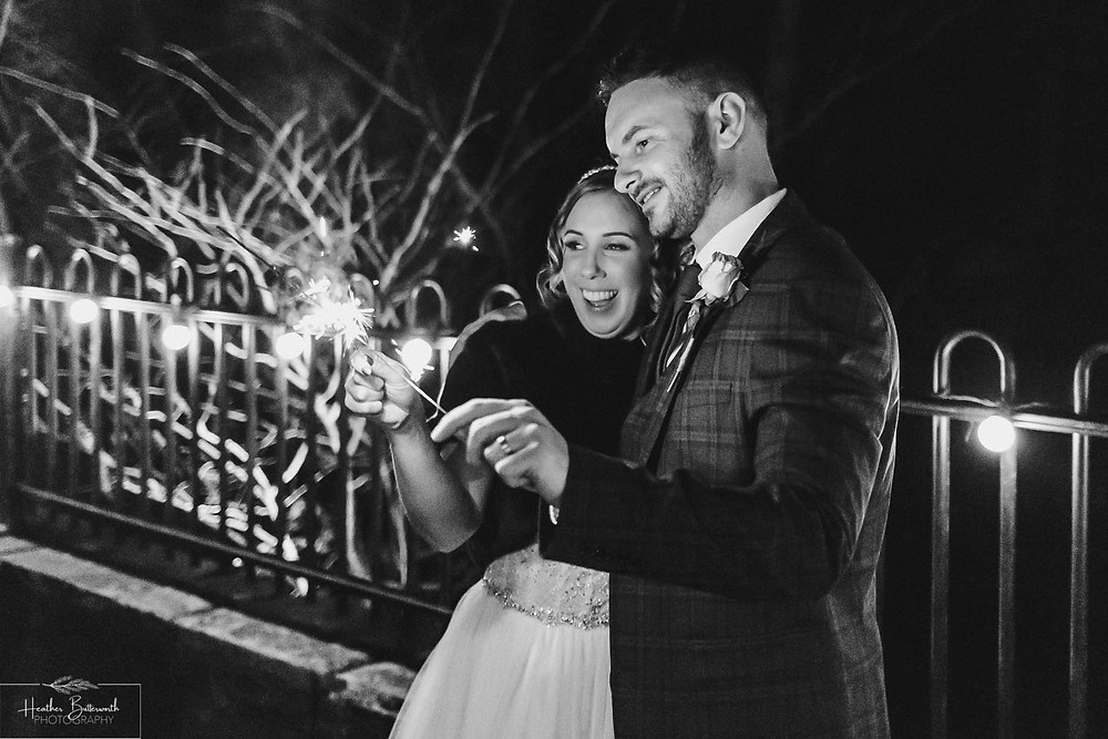 Bride and groom with sparklers at The Woodman Inn in Thunderbridge, Yorkshire