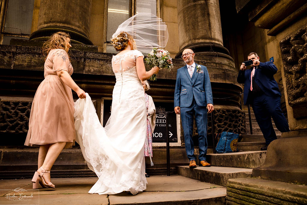 bride arriving and kissing her groom before her wedding in Leeds Yorkshire UK in august 2020