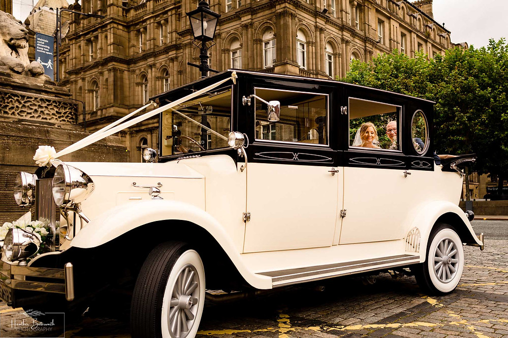 bride and her father arriving in a vintage car before her wedding in Leeds Yorkshire UK in august 2020