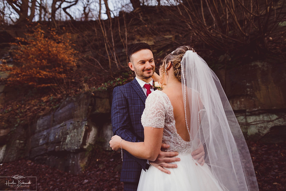 Groom looking happily at his bride after their wedding at The Woodman Inn in Thunderbridge near Leeds, Yorkshire