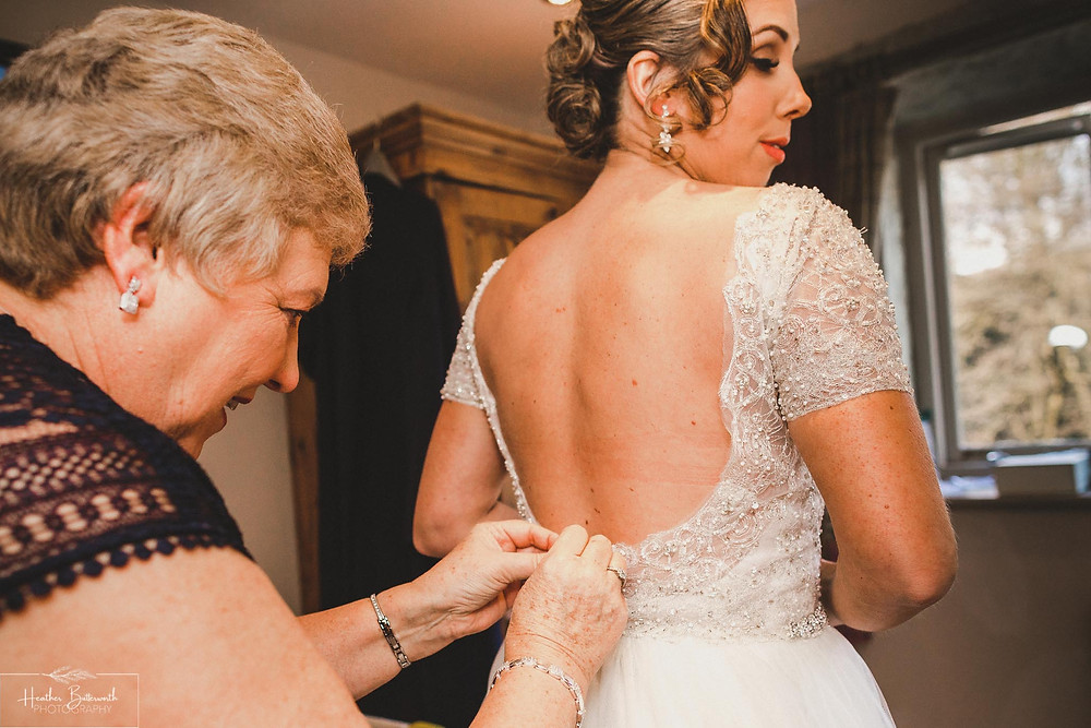 Bride preparing for her wedding at The Woodman Inn in Thunderbridge, Yorkshire