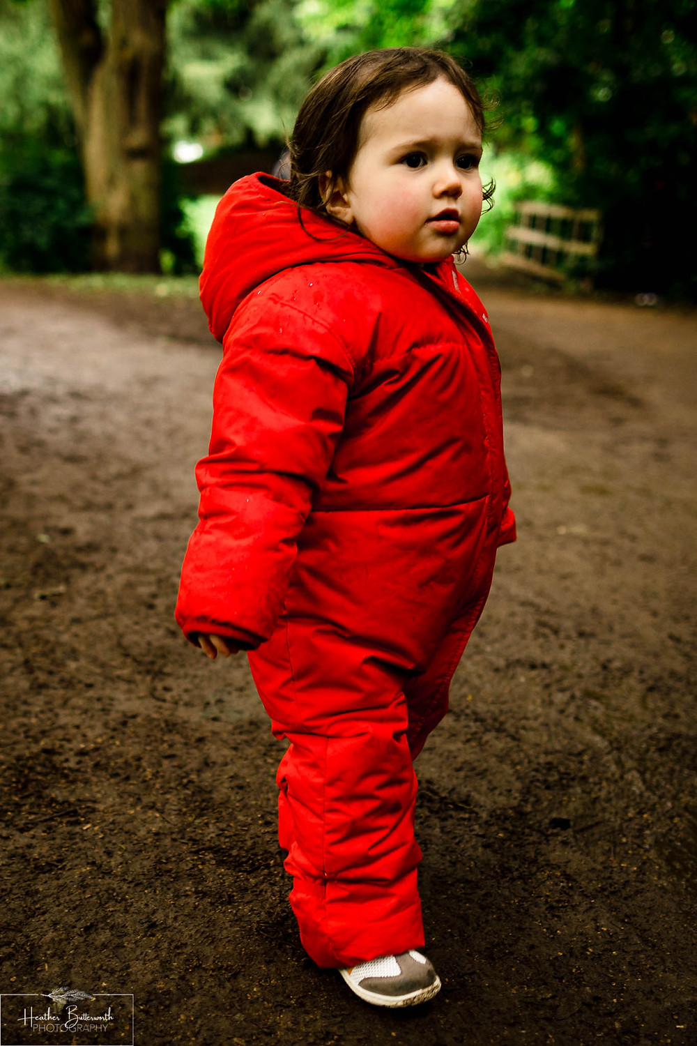 a girl playing in roundhay park woods after restrictions were slightly lifted after the COVID-19 lockdown in Leeds , Yorkshire in June 2020