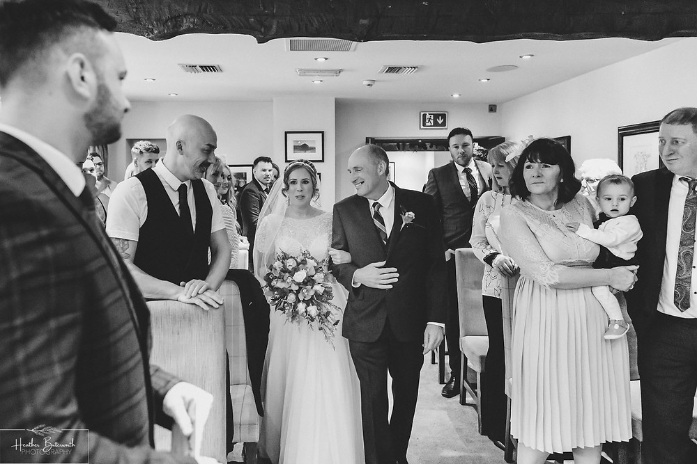 Bride and Groom during their wedding ceremony at The Woodman Inn in Thunderbridge, Yorkshire