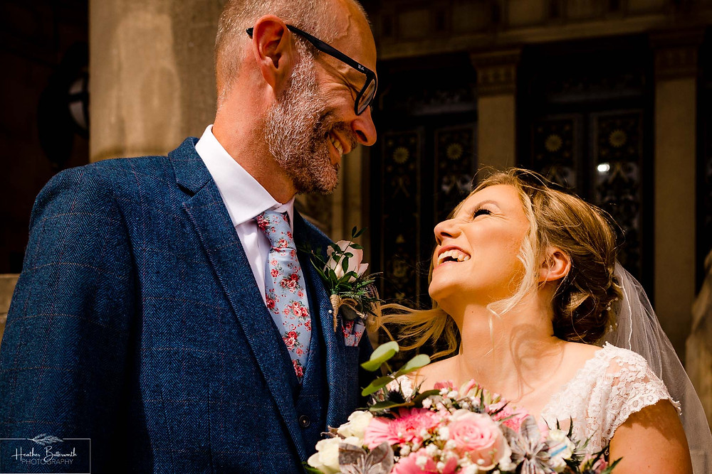 Bride and groom at Leeds Town Hall after their wedding in august 2020