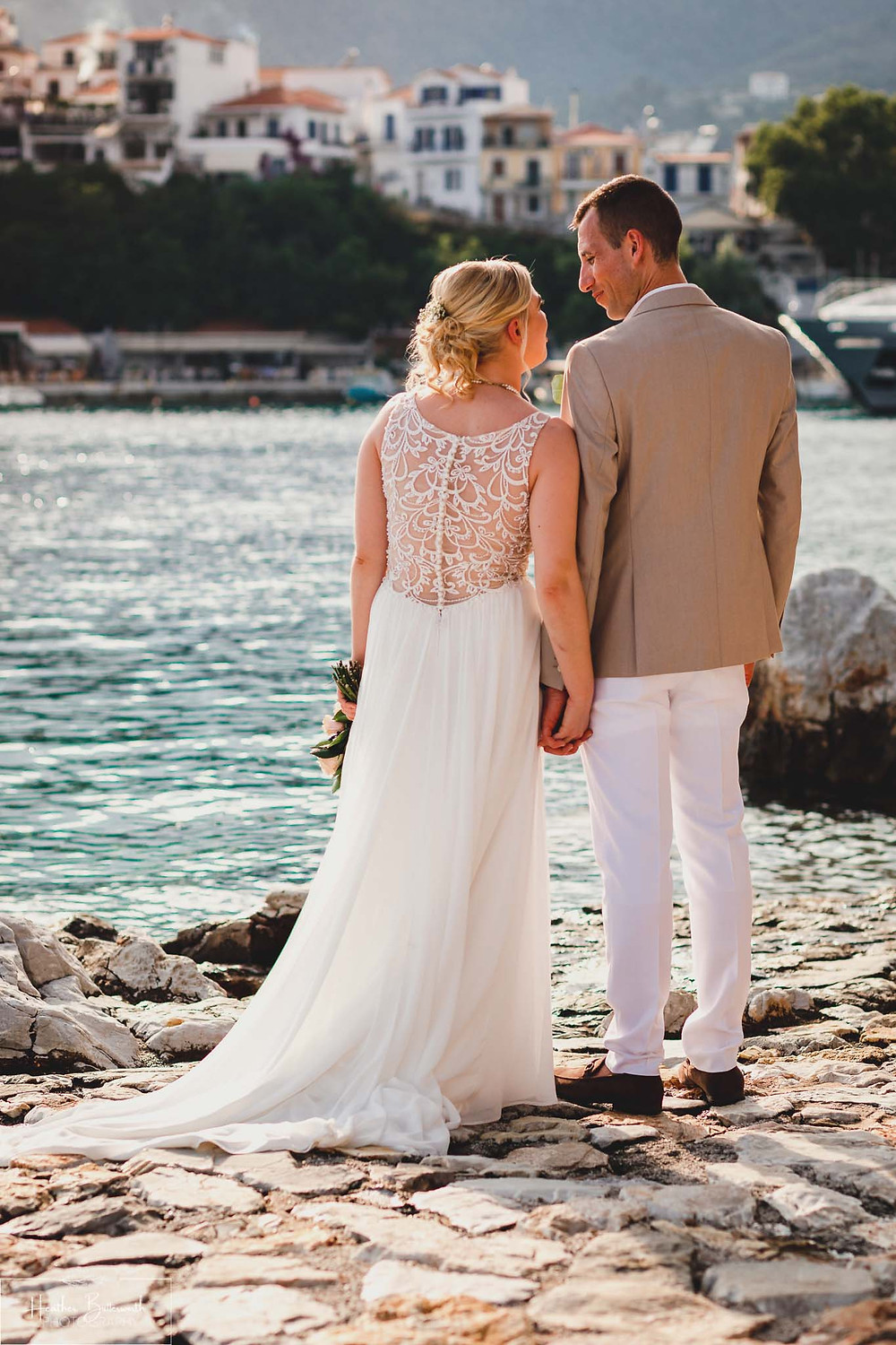 bride and groom looking at each other on the beach in skiathos