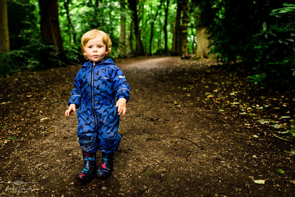 boy in roundhay park woods after restrictions were slightly lifted after the COVID-19 lockdown in Leeds , Yorkshire in June 2020