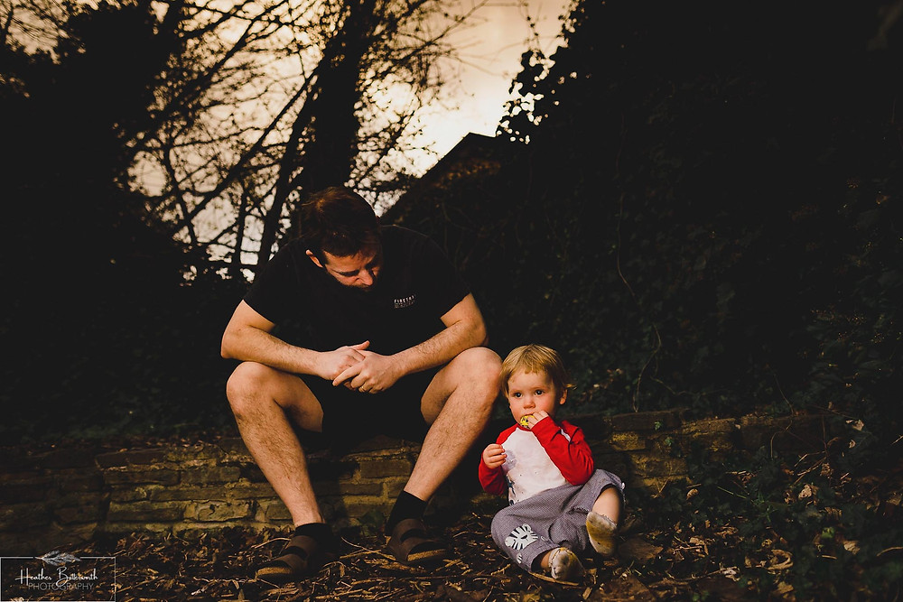 Dad and boy sat in the family garden in Leeds, Yorkshire. Image by Heather Butterworth Photography