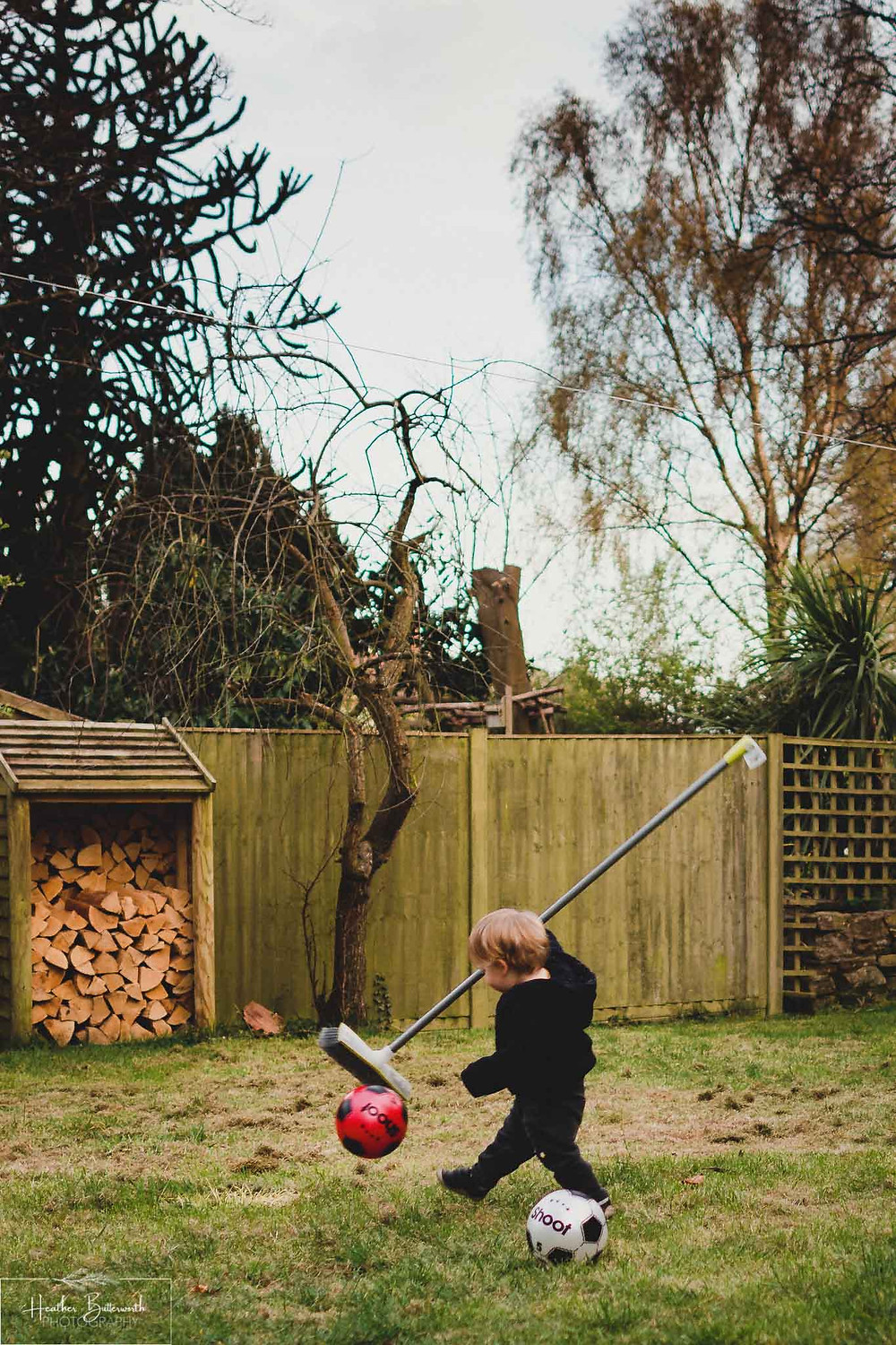toddler playing with a ball and a brush