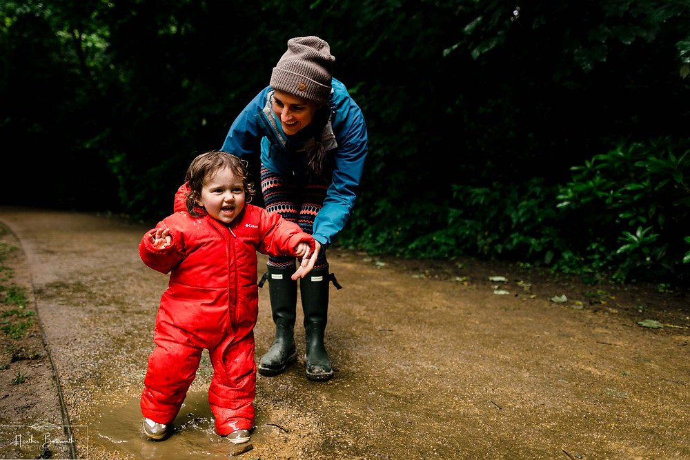 mother and daughter playing in roundhay park woods after restrictions were slightly lifted after the COVID-19 lockdown in Leeds , Yorkshire in June 2020