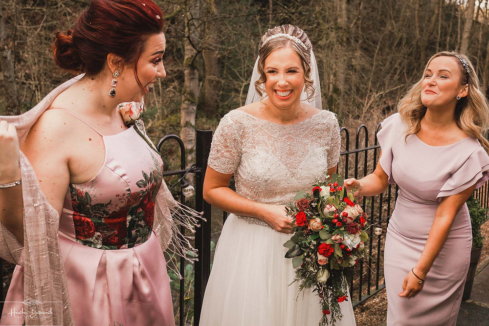 bride with family and friends natural wedding shot at the woodman inn Yorkshire leeds photographer