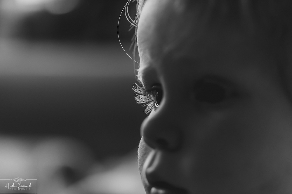 black and white close up of a toddlers eye