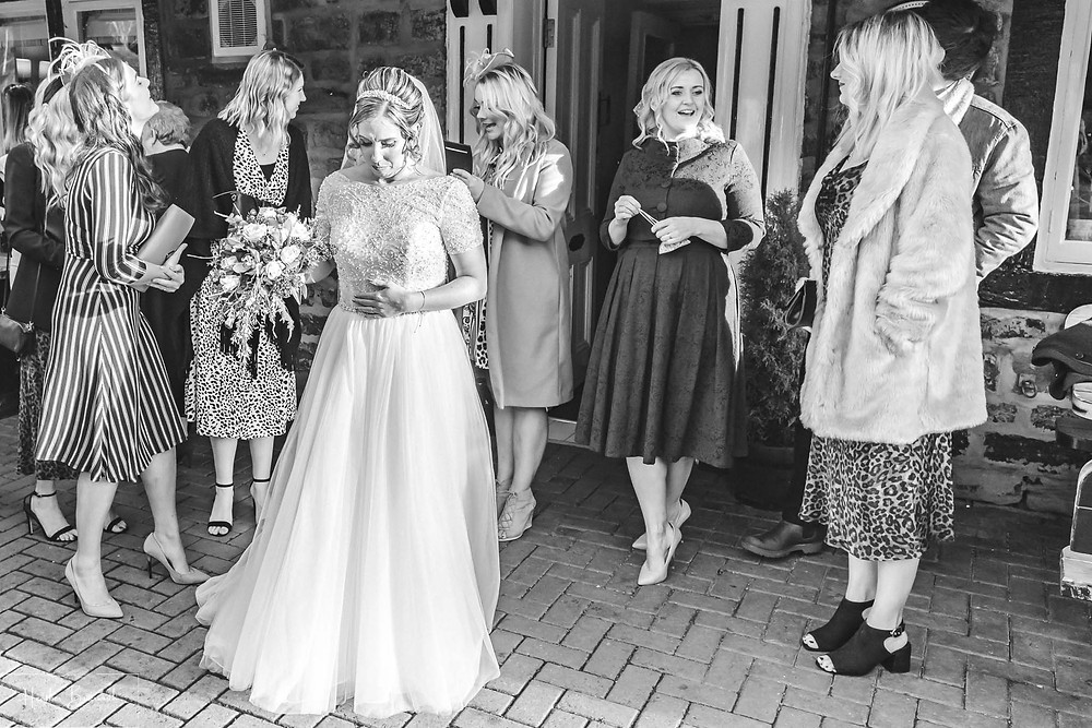 emotional bride after the wedding ceremony at the woodman inn Yorkshire leeds photographer
