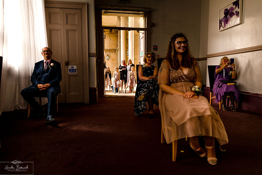 wedding guests at a socially distanced wedding at Leeds Town Hall in Yorkshire UK in august 2020