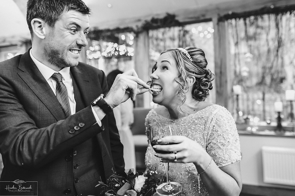 hungry bride being fed crisps after the wedding service at the woodman inn Yorkshire leeds photographer