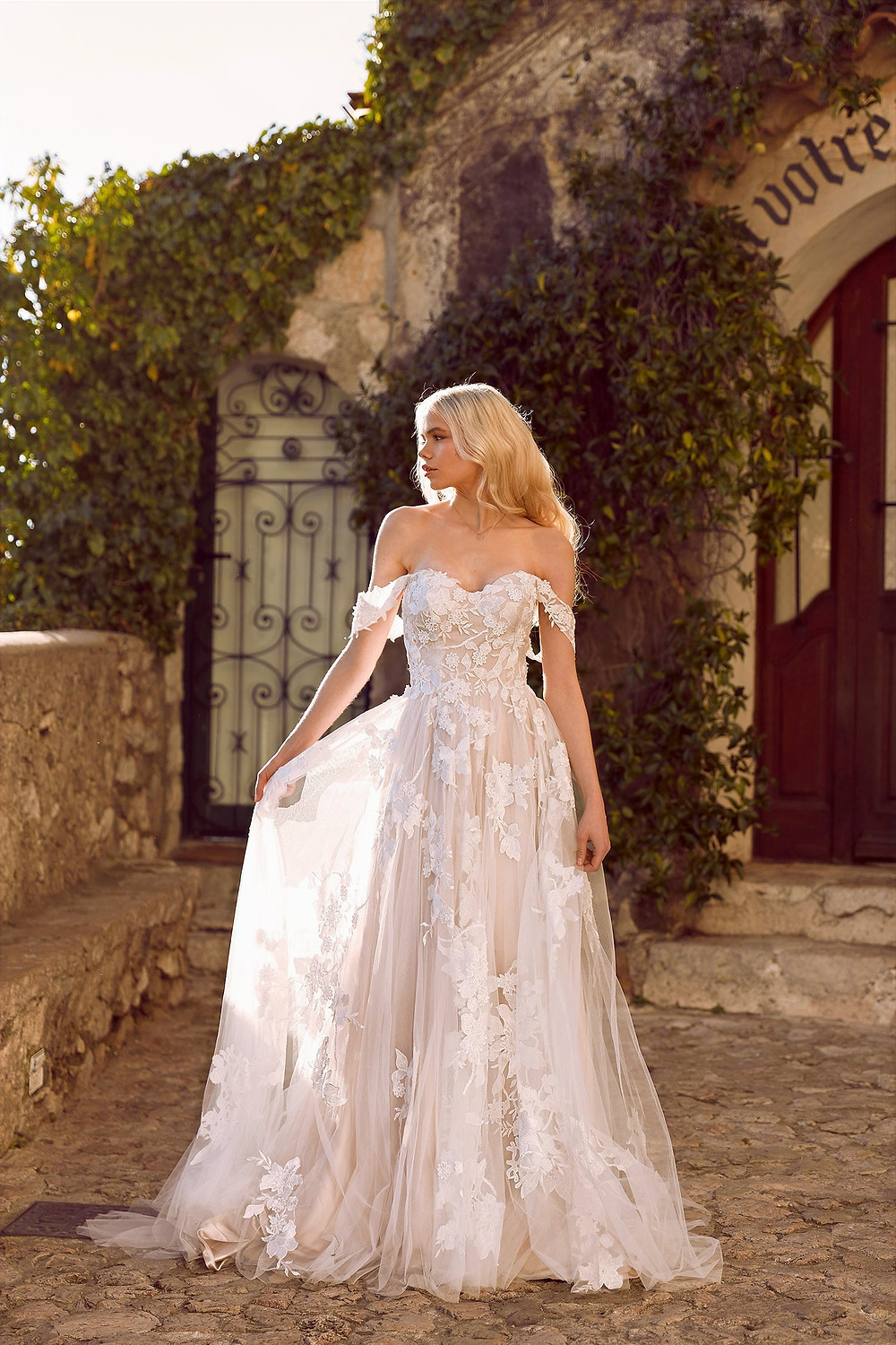 Model wearing a wedding dress in a courtyard